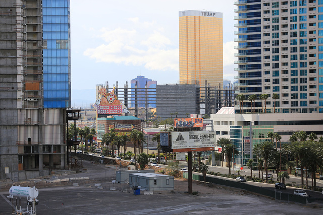 The skeleton of the unfinished Resorts World hotel-casino is seen between the unfinished Fontainebleau, left, and the Trump International on the Strip in Las Vegas on Friday, Dec. 23, 2016. The Ri ...