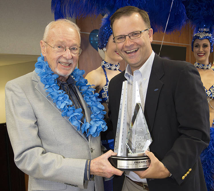Friendly Ford Friendly Ford owner Ed Olliges, left, is congratulated by Ford sales operation manager of the Phoenix region Phillip Chancellor, who presented Olliges with the Triple Crown award rec ...