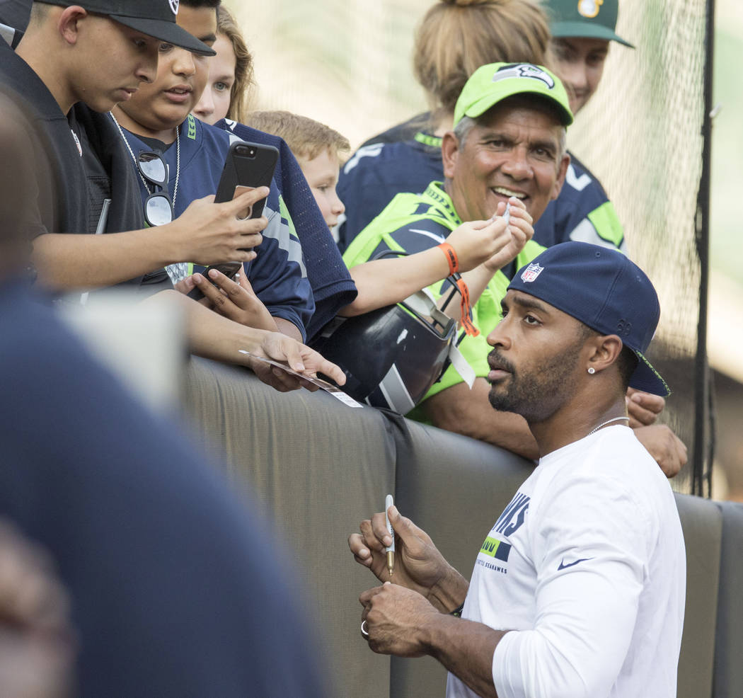 Seattle Seahawks wide receiver Doug Baldwin (89) signs autographs prior to a preseason game against the Oakland Raiders in Oakland, Calif., Thursday, Aug. 31, 2017. Heidi Fang Las Vegas Review-Jou ...