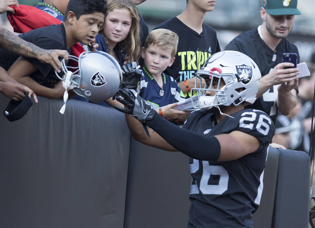 Oakland Raiders safety Shalom Luani (26) signs autographs prior to a preseason game against the Seattle Seahawks in Oakland, Calif., Thursday, Aug. 31, 2017. Heidi Fang Las Vegas Review-Journal @H ...