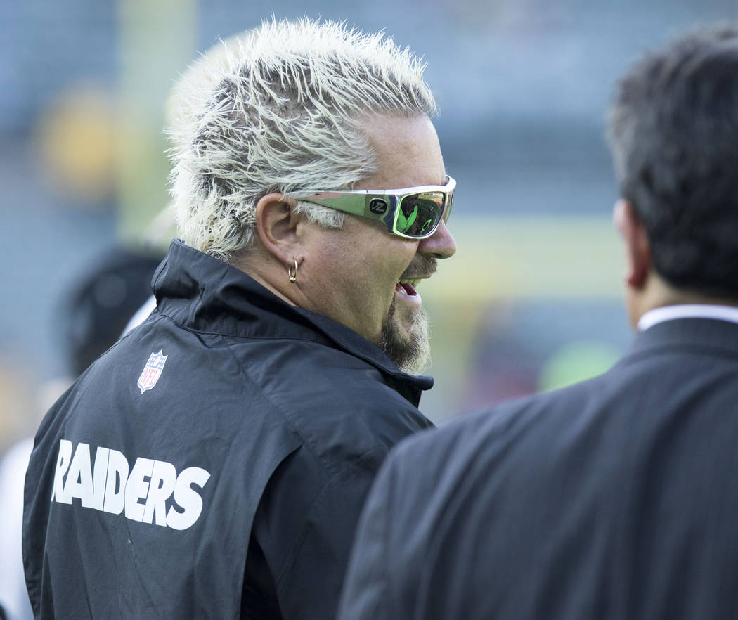 TV personality and restaurateur Guy Fieri on the sideline of the Oakland Raiders prior to the preseason game against Seattle Seahawks in Oakland, Calif., Thursday, Aug. 31, 2017. Heidi Fang Las Ve ...