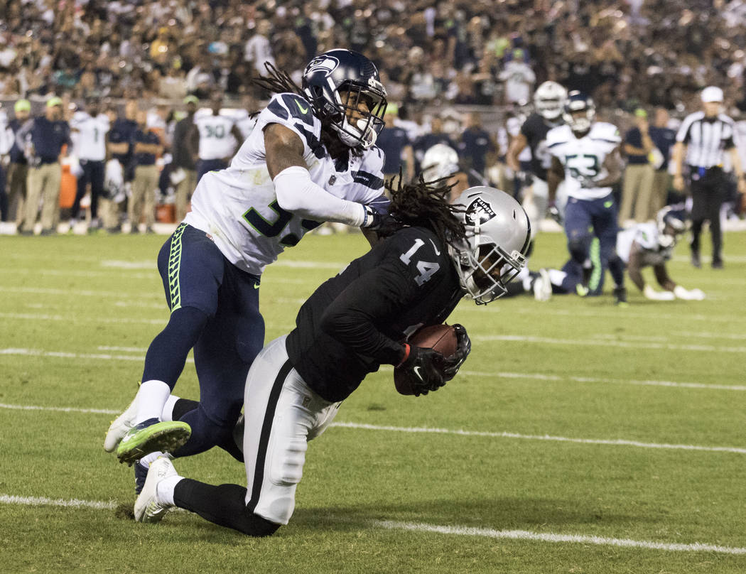 Oakland Raiders wide receiver Keon Hatcher (14) scores a touchdown in the first half of the preseason game against the Seattle Seahawks in Oakland, Calif., Thursday, Aug. 31, 2017. Heidi Fang Las  ...