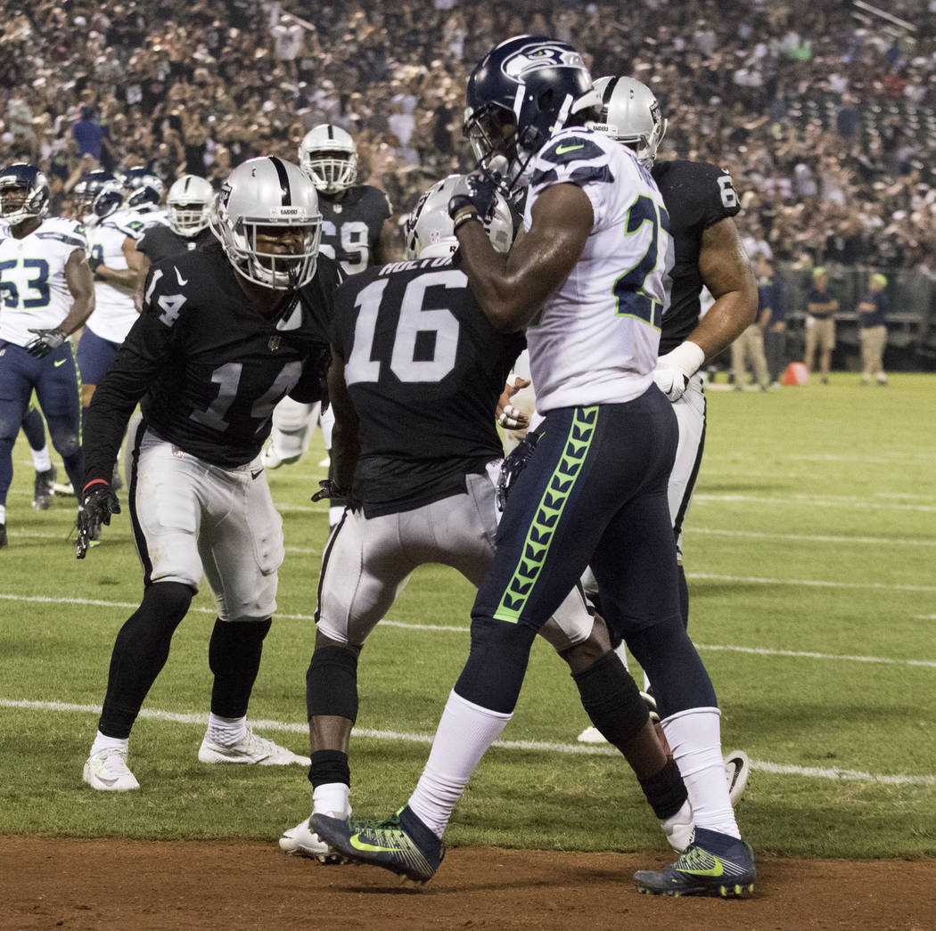Oakland Raiders wide receiver Keon Hatcher (14) celebrates scoring a touchdown in the first half of the preseason game against the Seattle Seahawks in Oakland, Calif., Thursday, Aug. 31, 2017. Hei ...