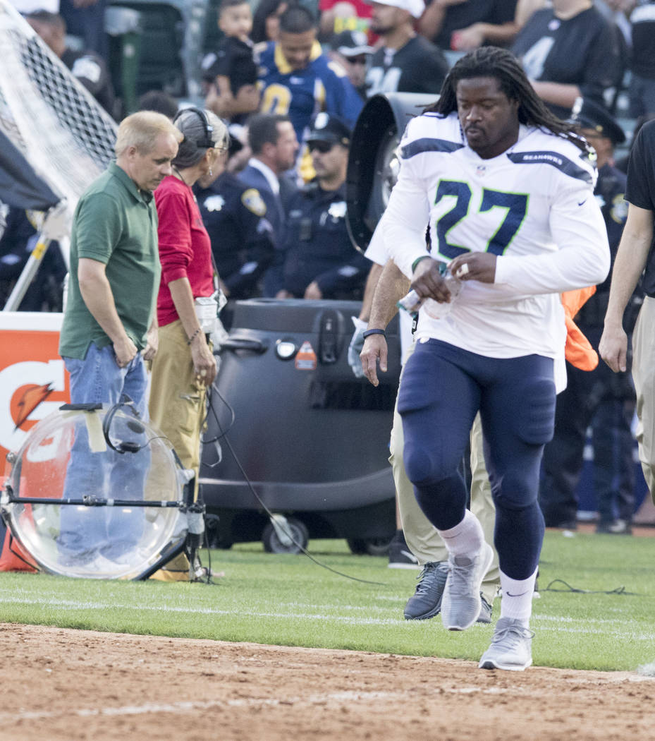 Seattle Seahawks running back Eddie Lacy (27) takes the field prior to the start of a NFL preseason game against Oakland Raiders in Oakland, Calif., Thursday, Aug. 31, 2017. Heidi Fang Las Vegas R ...