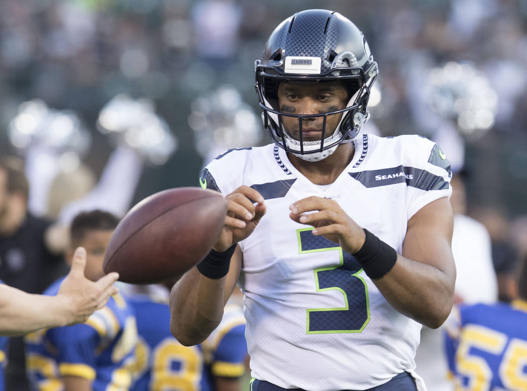Seattle Seahawks quarterback Russell Wilson (3) warms up prior to a NFL preseason game against the Oakland Raiders in Oakland, Calif., Thursday, Aug. 31, 2017. Heidi Fang Las Vegas Review-Journal  ...