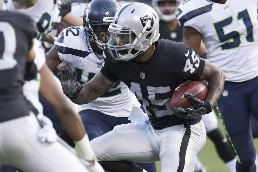 Oakland Raiders running back George Atkinson (45) carries the ball in the first half of their preseason game against the Seattle Seahawks in Oakland, Thursday, Aug. 31, 2017. Heidi Fang Las Vegas  ...
