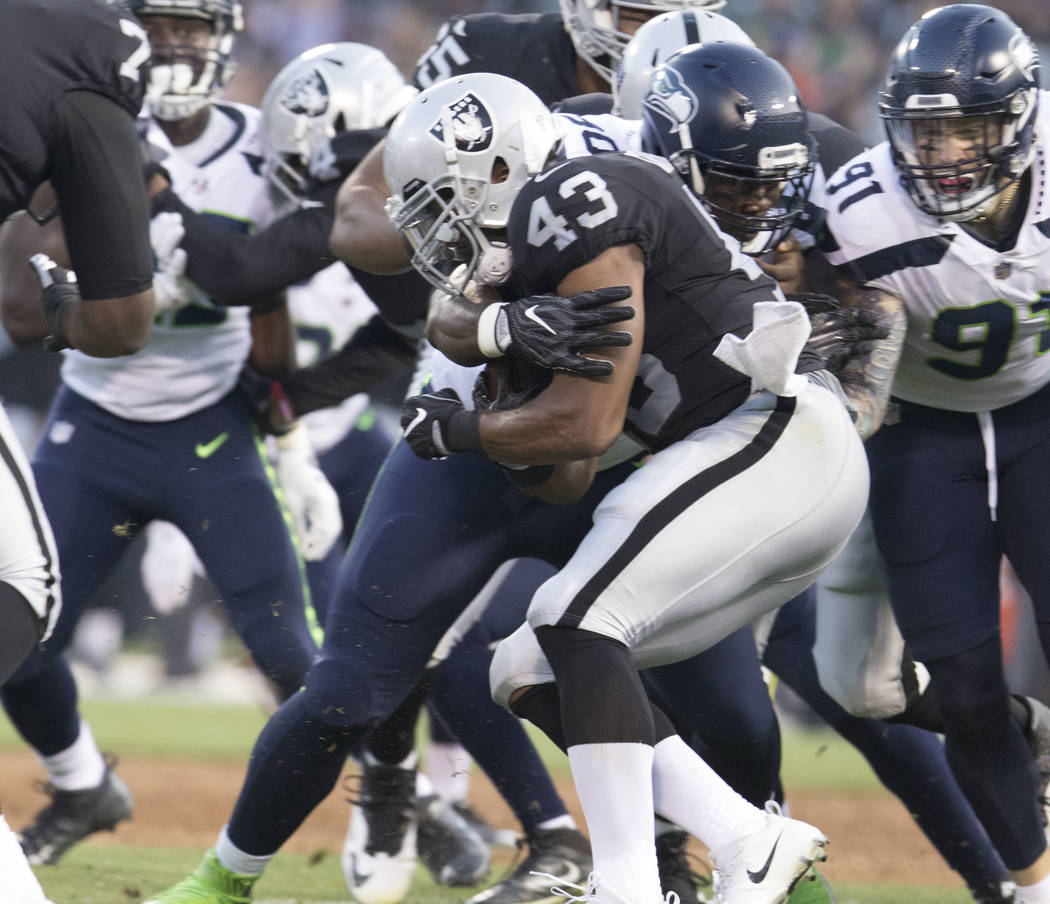 Oakland Raiders running back John Crockett (43) carries the ball in the first half of their preseason game against the Seattle Seahawks in Oakland, Calif., Thursday, Aug. 31, 2017. Heidi Fang Las  ...