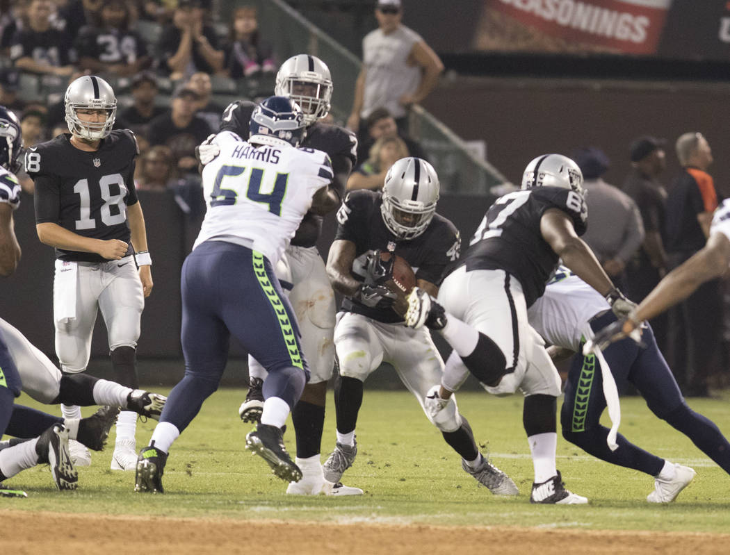 Oakland Raiders running back George Atkinson (45) carries the ball in the first half of a preseason game against the Seattle Seahawks in Oakland, Calif., Thursday, Aug. 31, 2017. Heidi Fang Las Ve ...