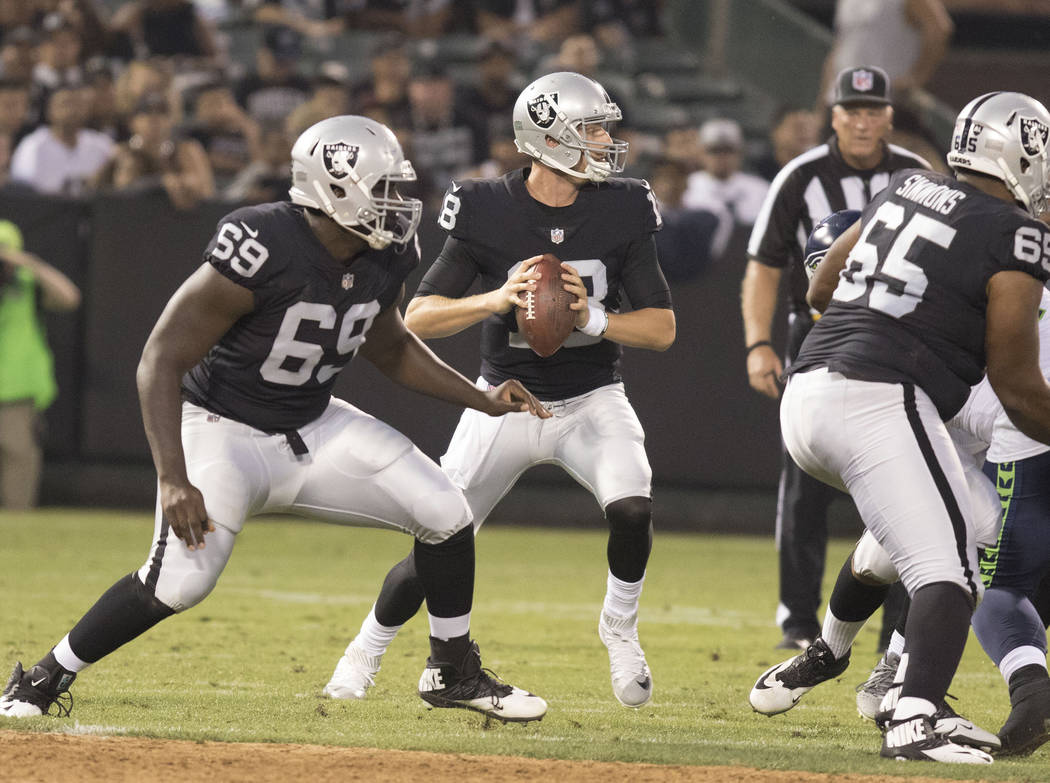 Oakland Raiders quarterback Connor Cook (18) prepares to throw the ball in the first half of their preseason game against the Seattle Seahawks in Oakland, Calif., Thursday, Aug. 31, 2017. Heidi Fa ...