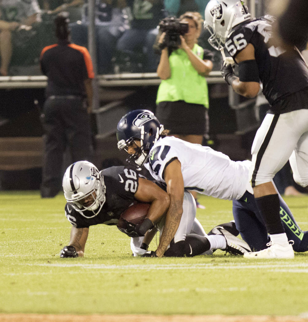 Oakland Raiders safety Shalom Luani (26) intercepts the Seattle Seahawks in the first half of their preseason game in Oakland, Calif., Thursday, Aug. 31, 2017. Heidi Fang Las Vegas Review-Journal  ...
