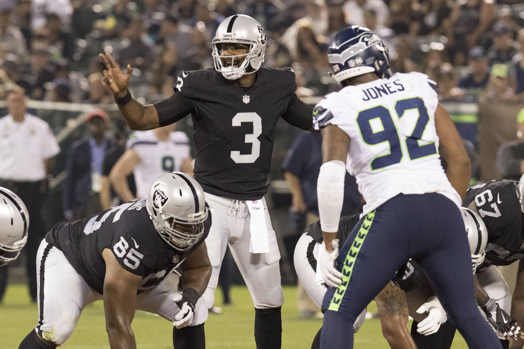 Oakland Raiders quarterback EJ Manuel (3) calls a play in the first half of the preseason game against Seattle Seahawks in Oakland, Calif., Thursday, Aug. 31, 2017. Heidi Fang Las Vegas Review-Jou ...