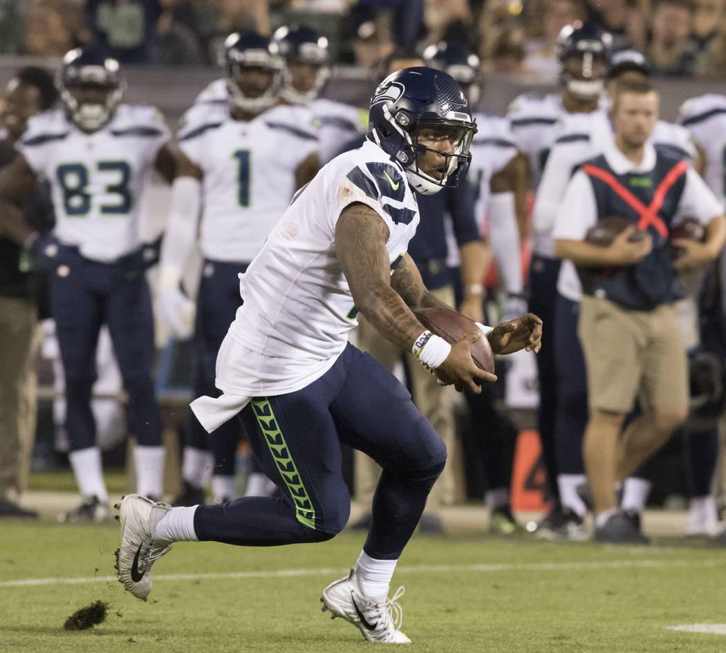 Seattle Seahawks quarterback Trevone Boykin (2) runs the ball in the first half of the preseason game against the Oakland Raiders in Oakland, Calif., Thursday, Aug. 31, 2017. Heidi Fang Las Vegas  ...