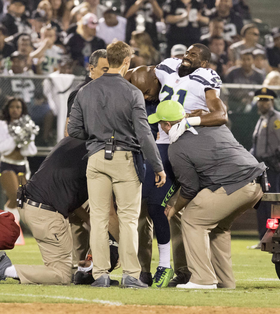 Injured Seattle Seahawks cornerback DeAndre Elliott (21) is lifted onto a cart in the first half of the preseason game in Oakland, Calif., Thursday, Aug. 31, 2017. Heidi Fang Las Vegas Review-Jour ...