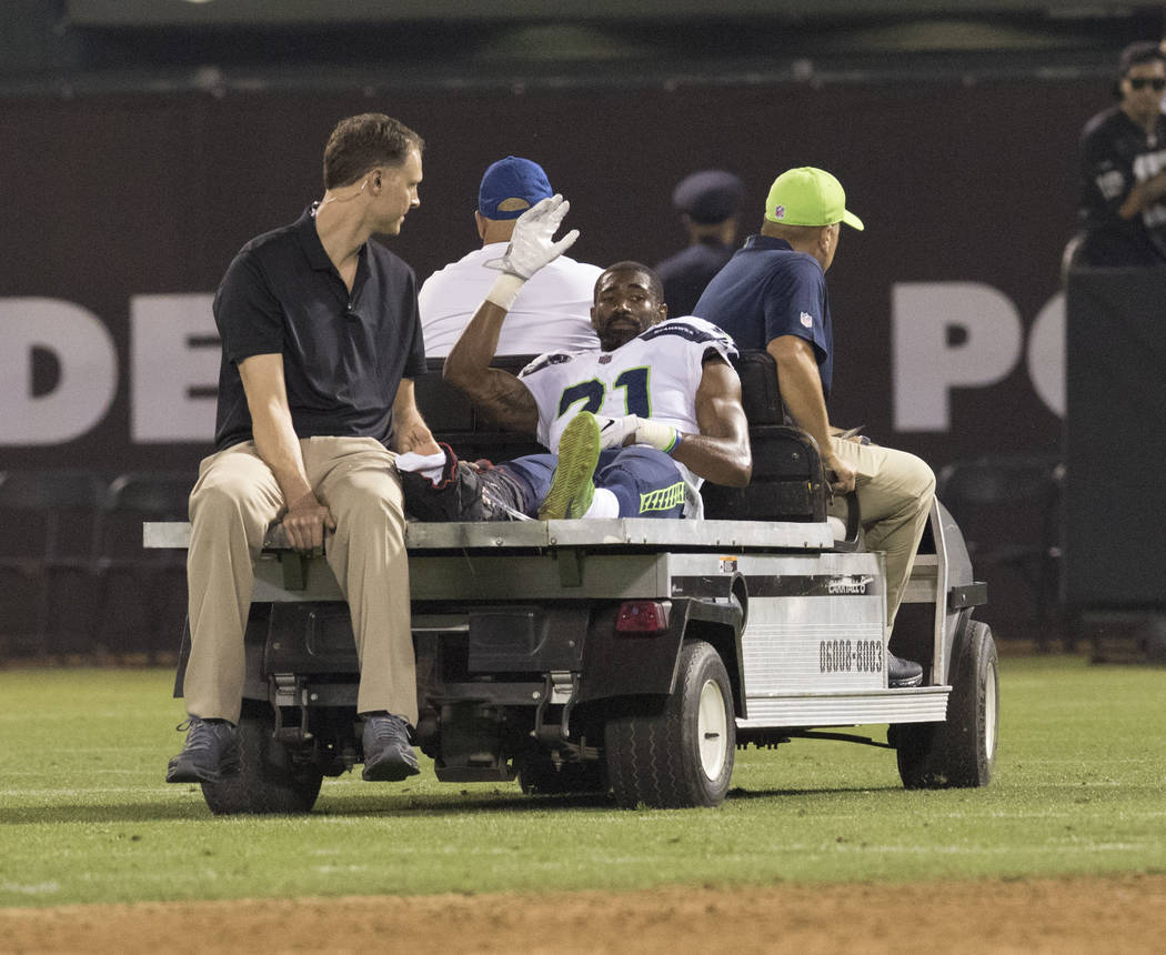 Injured Seattle Seahawks cornerback DeAndre Elliott (21) is carted off the field in the first half of the preseason game in Oakland, Calif., Thursday, Aug. 31, 2017. Heidi Fang Las Vegas Review-Jo ...