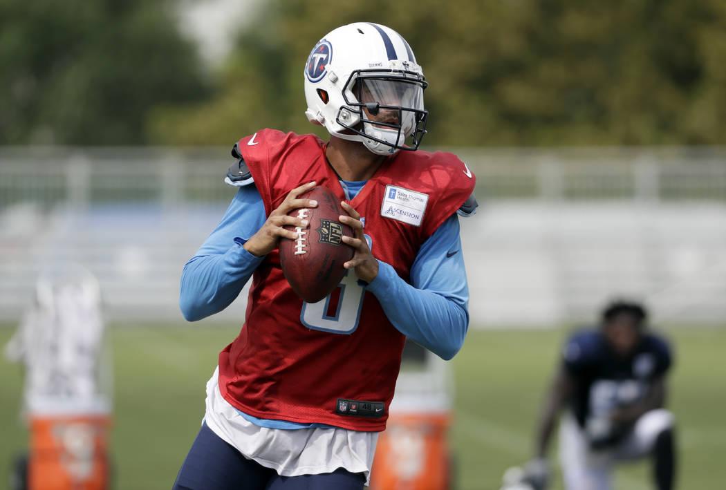 Tennessee Titans quarterback Marcus Mariota passes during NFL football training camp Thursday, Aug. 10, 2017, in Nashville, Tenn. (AP Photo/Mark Humphrey)