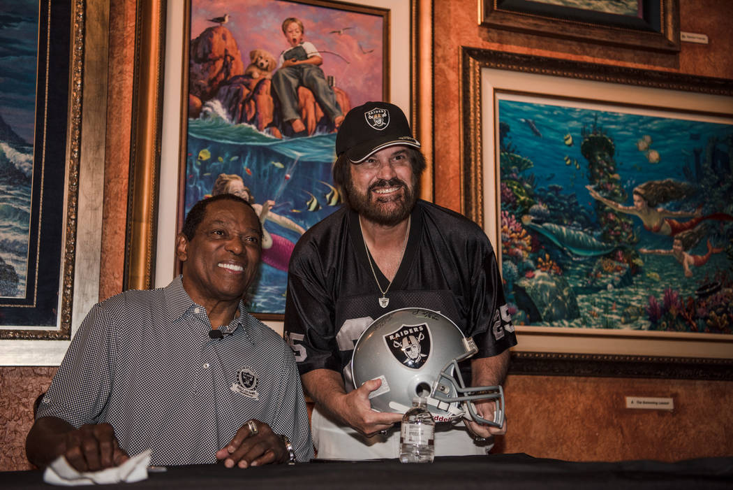 Cliff Branch, a former wide receiver for the Raiders, takes a photo with Art Cook at the Mermaid Lounge at Silverton hotel-casino on Saturday, Sep. 9, 2017, in Las Vegas. Morgan Lieberman Las Vega ...
