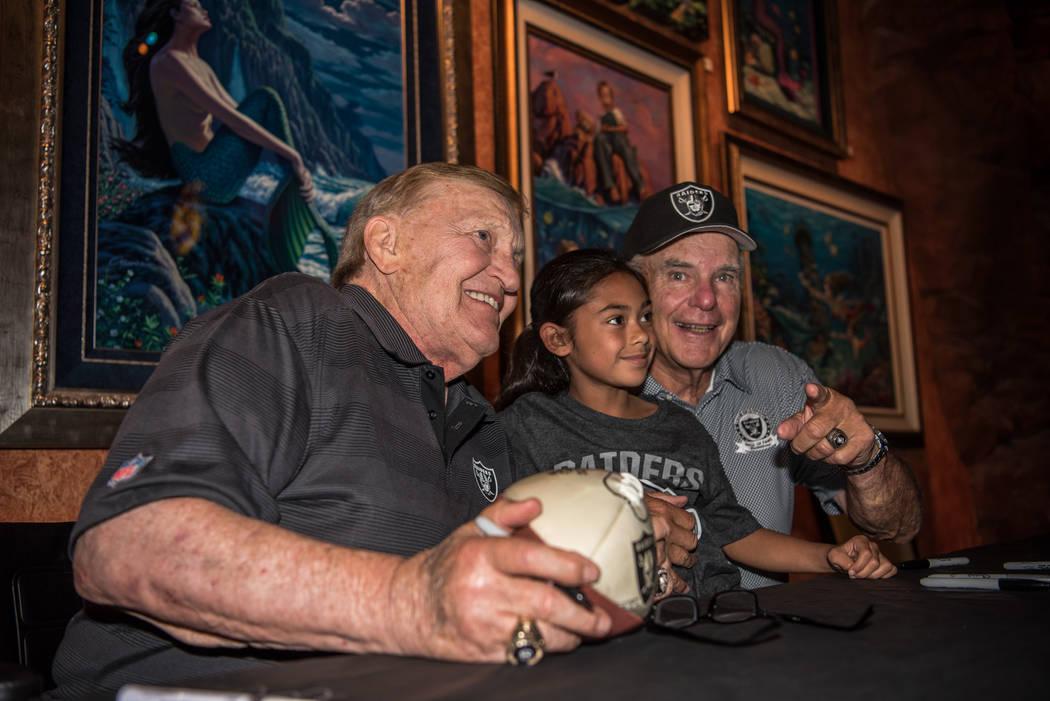 Former Raiders center Jim Otto and quarterback Daryle Lamonica take a photo with Tehani Paulo, 8, at the Mermaid Lounge at Silverton hotel-casino on Saturday, Sep. 9, 2017, in Las Vegas. Morgan Li ...