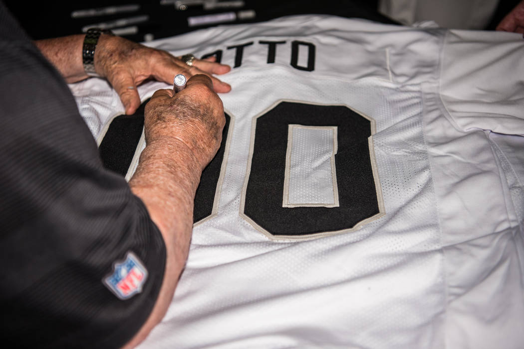 Former Raiders center Jim Otto signs a jersey at the Mermaid Lounge at Silverton hotel-casino on Saturday, Sep. 9, 2017, in Las Vegas. Morgan Lieberman Las Vegas Review-Journal