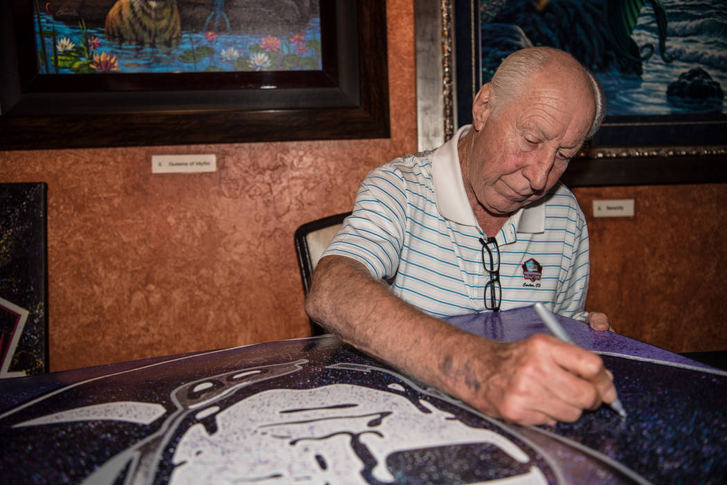 Former Raiders' wide receiver Fred Biletnikoff signs a large canvas at the Mermaid Lounge at Silverton hotel-casino on Saturday, Sep. 9, 2017, in Las Vegas. Morgan Lieberman Las Vegas Review-Journal