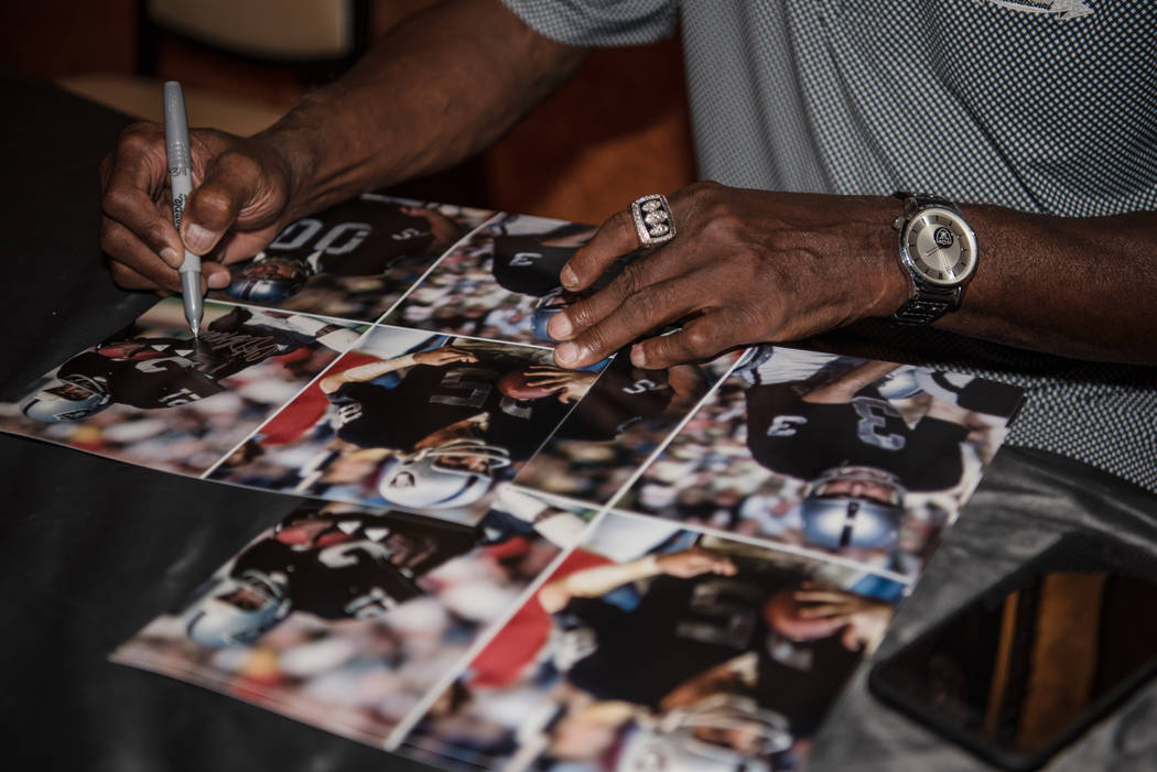 Former Raiders wide receiver Cliff Branch signs a photo of himself at the Mermaid Lounge at Silverton hotel-casino on Saturday, Sep. 9, 2017, in Las Vegas. Morgan Lieberman Las Vegas Review-Journal