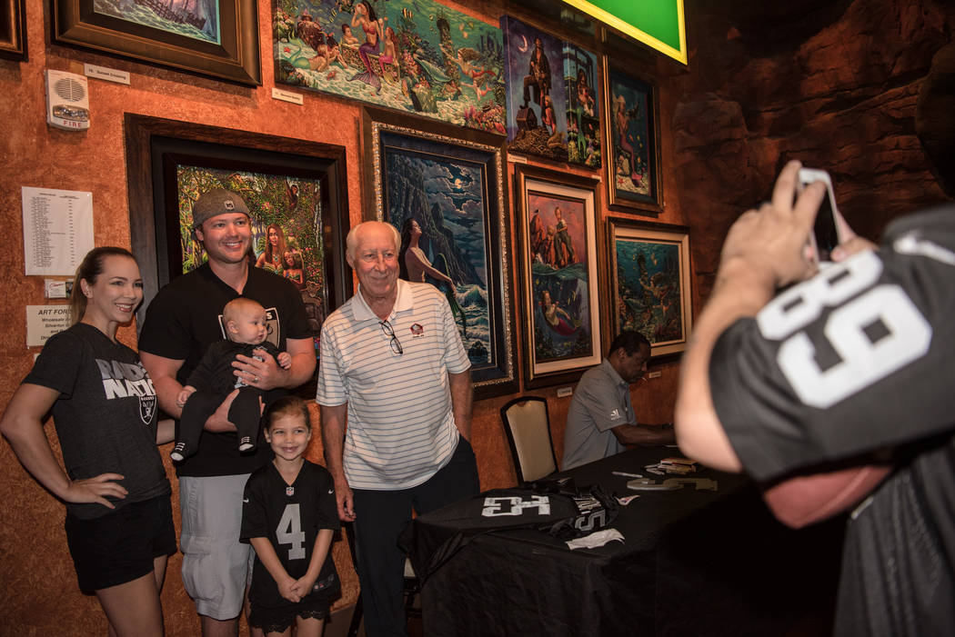 Former Raiders' wide receiver Fred Biletnikoff takes a photo with the Fiel family at the Mermaid Lounge at Silverton hotel-casino on Saturday, Sep. 9, 2017, in Las Vegas. Morgan Lieberman Las Vega ...