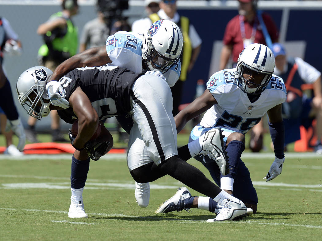 Oakland Raiders wide receiver Amari Cooper (89) breaks away from Tennessee Titans free safety Kevin Byard (31) and cornerback Adoree' Jackson (25) as Cooper scores a touchdown on an 8-yard pass in ...