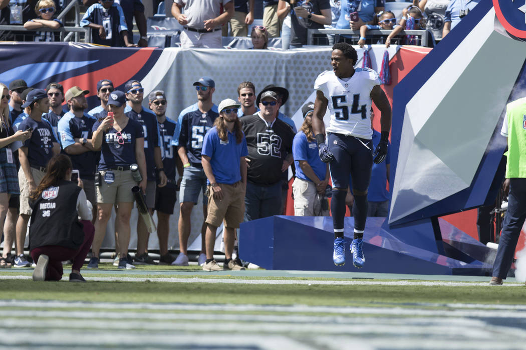 Tennessee Titans inside linebacker Avery Williamson (54) comes on to the Nissan Stadium field for their game against the Oakland Raiders in Nashville, Tenn., Sunday, Sept. 10, 2017. Heidi Fang Las ...