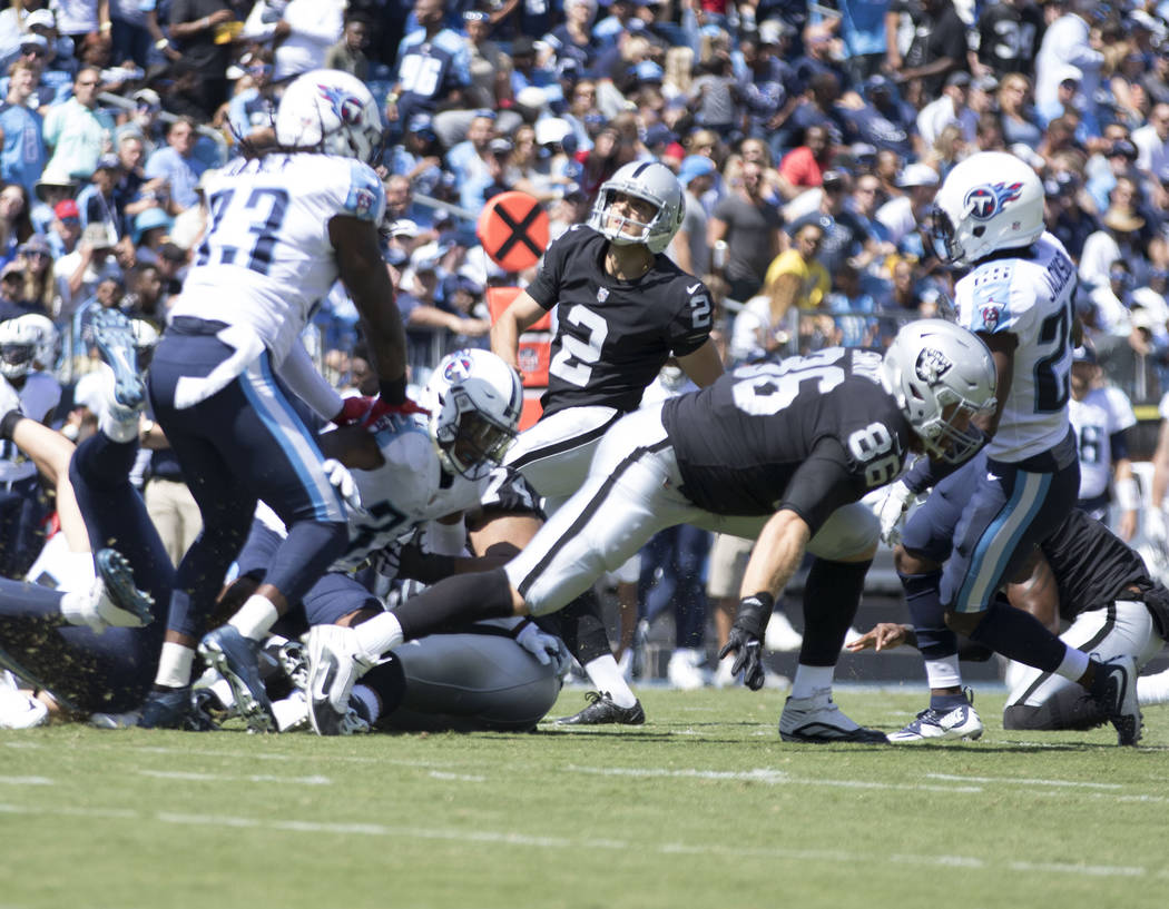 Oakland Raiders kicker Giorgio Tavecchio adds the extra point after Oakland Raiders wide receiver Amari Cooper (89) touchdown in the first quarter against the Tennessee Titans at the Nissan Stadiu ...