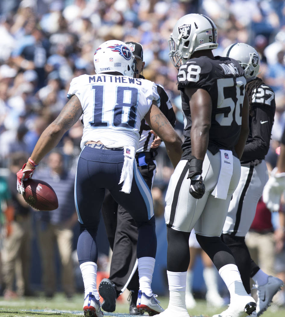 Tennessee Titans wide receiver Rishard Matthews (18) catches a pass in the first half of their game against the Oakland Raiders at the Nissan Stadium in Nashville, Tenn., Sunday, Sept. 10, 2017. H ...