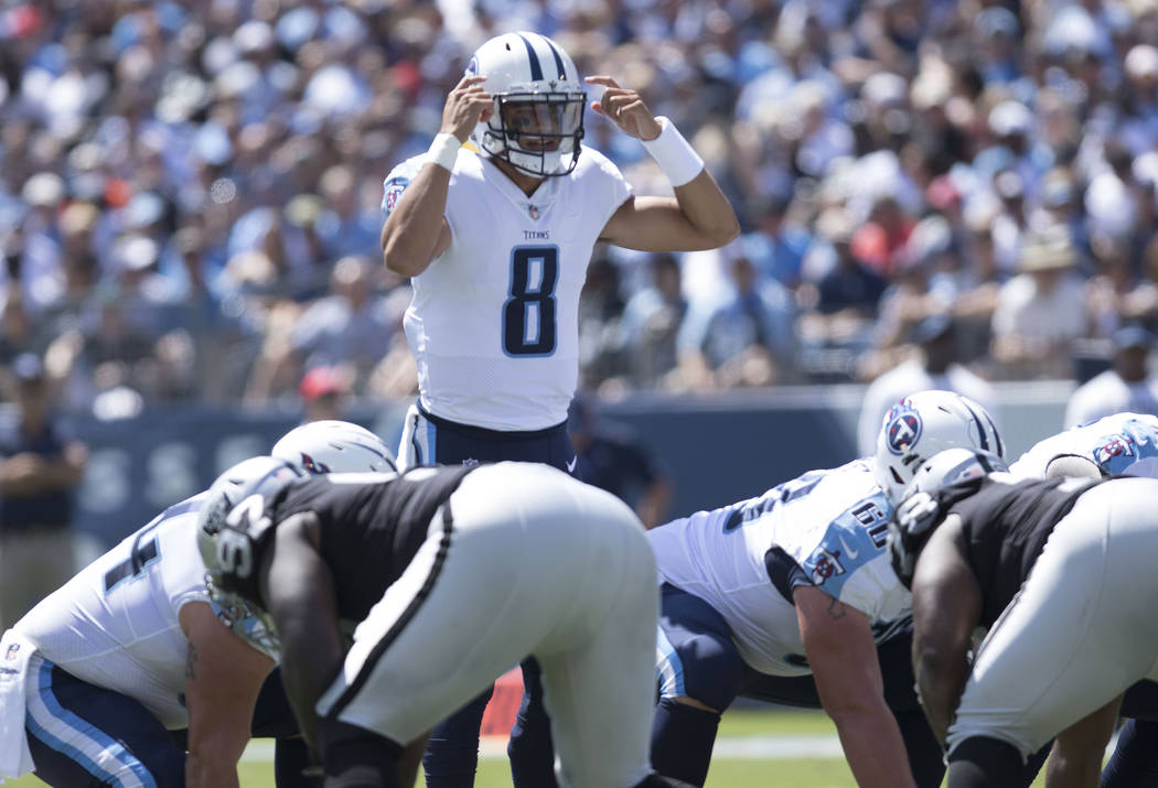 Tennessee Titans quarterback Marcus Mariota (8) calls a play in the first half of their game against the Oakland Raiders at the Nissan Stadium in Nashville, Tenn., Sunday, Sept. 10, 2017. Heidi Fa ...
