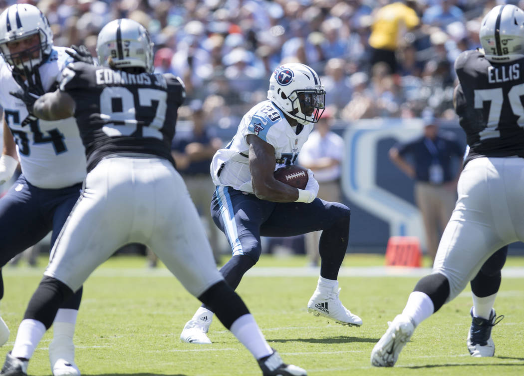 Tennessee Titans running back DeMarco Murray (29) runs with the football in the first half of their game against the Oakland Raiders at the Nissan Stadium in Nashville, Tenn., Sunday, Sept. 10, 20 ...