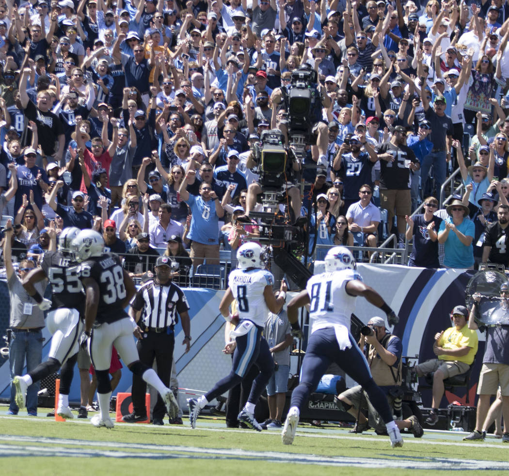 Tennessee Titans quarterback Marcus Mariota (8) scores a touchdown in the first half of their game against the Oakland Raiders at the Nissan Stadium in Nashville, Tenn., Sunday, Sept. 10, 2017. He ...