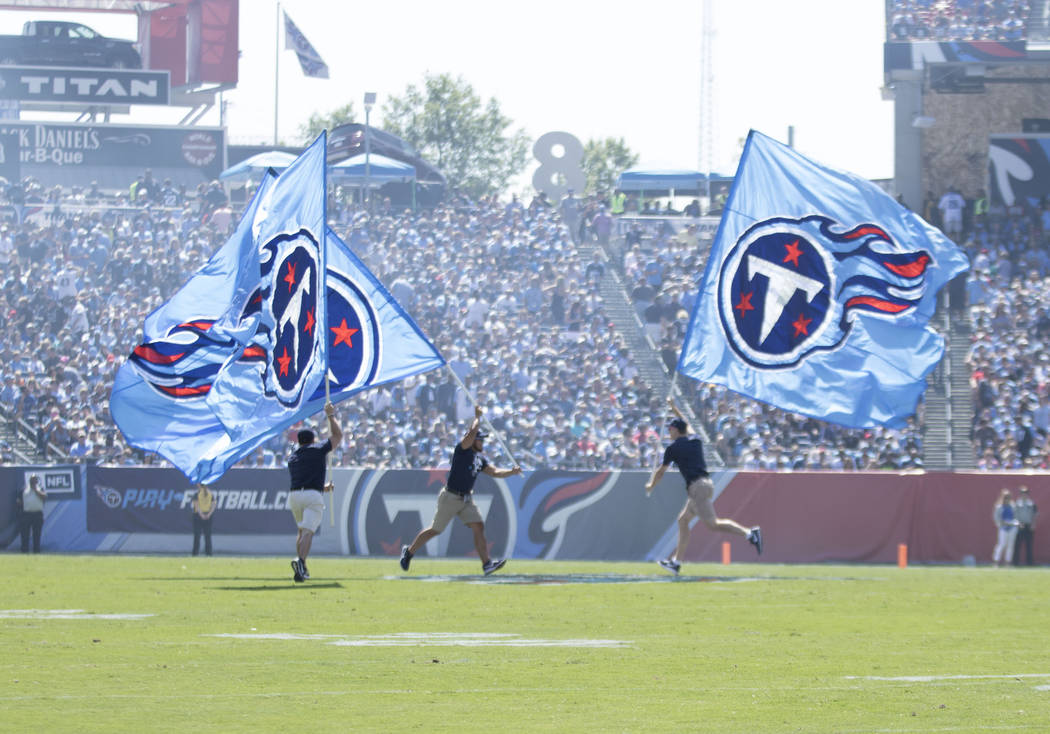 Tennessee Titans flags on the field after the team scored a touchdown in the first half of their game against the Oakland Raiders at the Nissan Stadium in Nashville, Tenn., Sunday, Sept. 10, 2017. ...