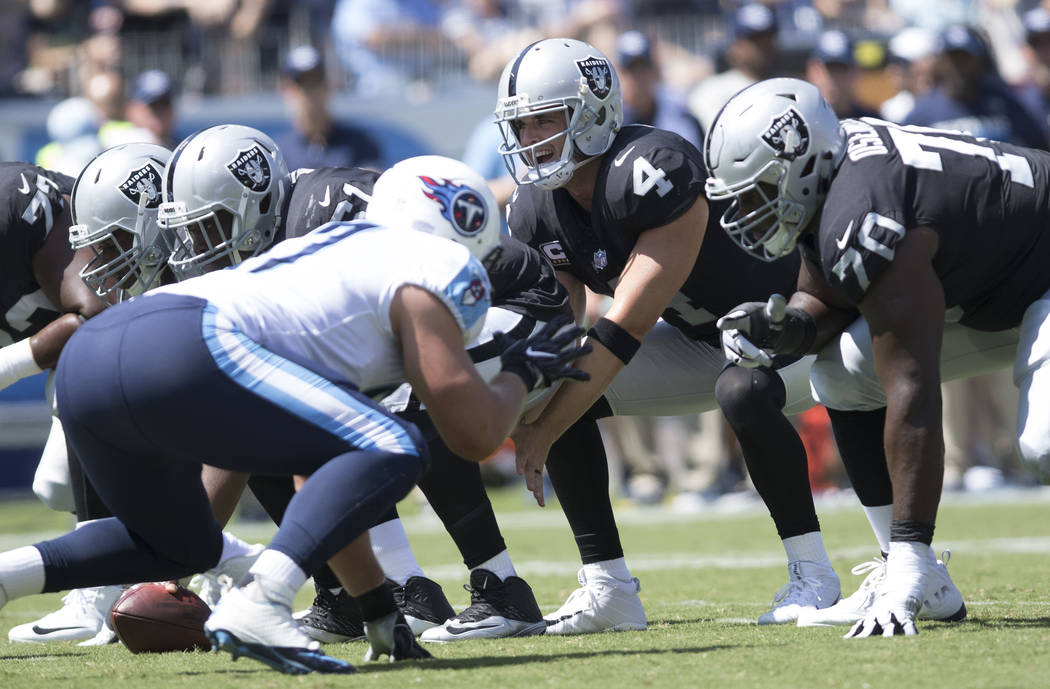 Oakland Raiders quarterback Derek Carr (4) calls a play in the first half of their game against the Tennessee Titans at the Nissan Stadium in Nashville, Tenn., Sunday, Sept. 10, 2017. Heidi Fang L ...