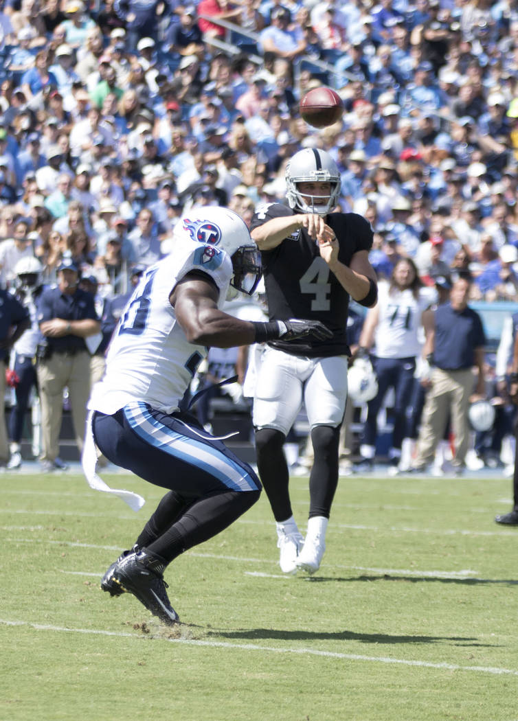 Oakland Raiders quarterback Derek Carr (4) throws the ball in the first half of their game against the Tennessee Titans at the Nissan Stadium in Nashville, Tenn., Sunday, Sept. 10, 2017. Heidi Fan ...