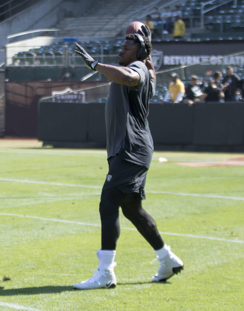 Oakland Raiders defensive end Khalil Mack (52) warms up on the field prior to the start of their game against the New York Jets in Oakland, Calif., Sunday, Sept. 17, 2017. Heidi Fang Las Vegas Rev ...