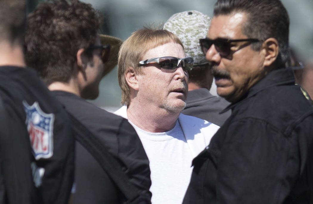 Oakland Raiders owner Mark Davis, center, on the field prior to the start of the team's game against the New York Jets in Oakland, Calif., Sunday, Sept. 17, 2017. Heidi Fang Las Vegas Review-Journ ...