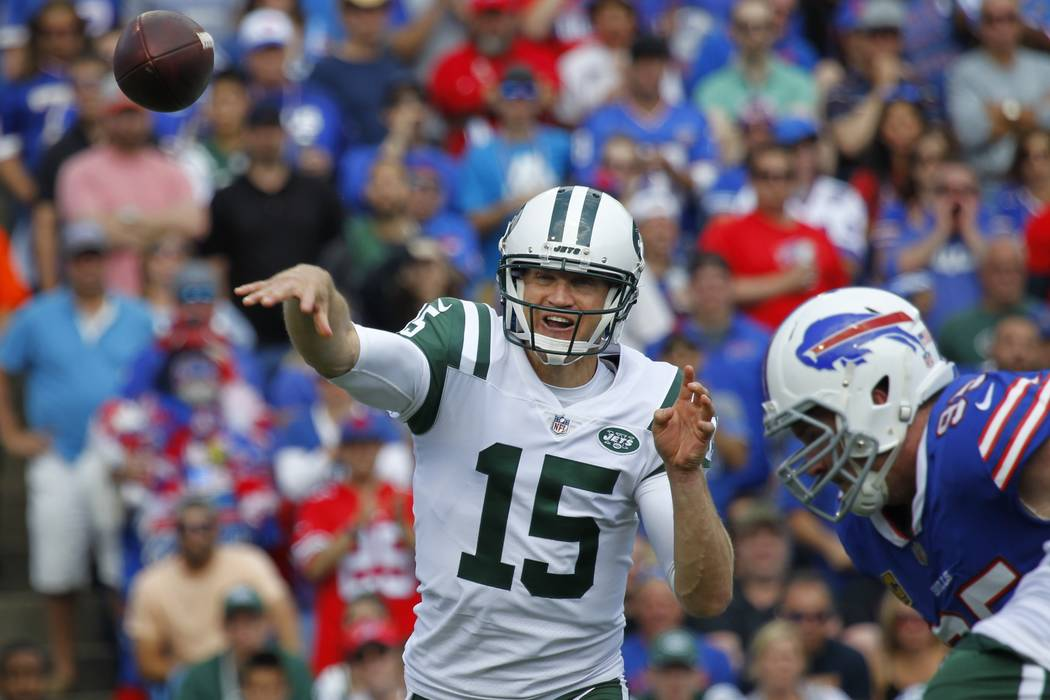 New York Jets quarterback Josh McCown (15) throws a pass away from Buffalo Bills' Marcell Dareus (99) during the first half of an NFL football game Sunday, Sept. 10, 2017, in Orchard Park, N.Y. (A ...