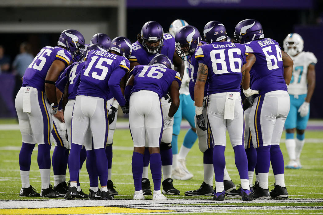 Minnesota Vikings players huddle during the second half of an NFL preseason football game against the Miami Dolphins, Thursday, Aug. 31, 2017, in Minneapolis. (AP Photo/Jim Mone)
