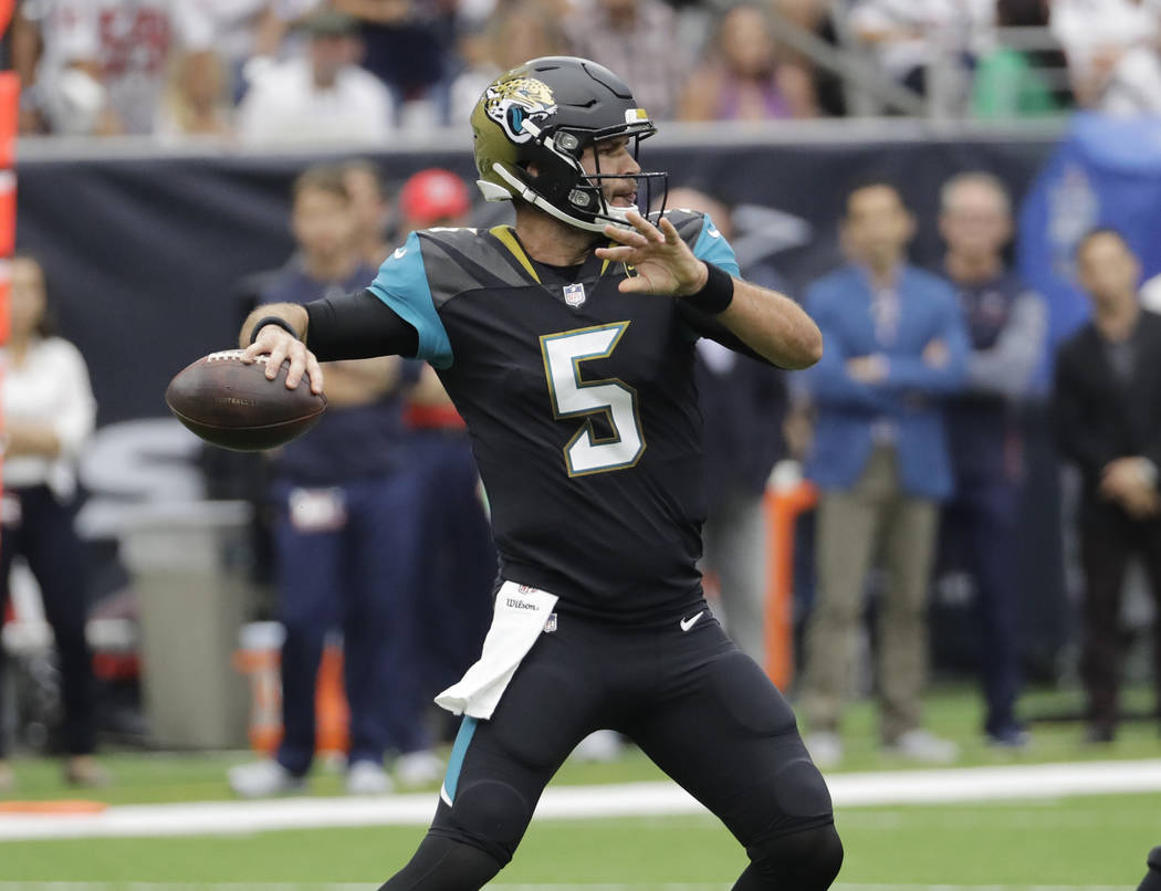 Jacksonville Jaguars quarterback Blake Bortles (5) drops back to pass against the Houston Texans in the first half of an NFL football game Sunday, Sept. 10, 2017, in Houston. (AP Photo/David J. Ph ...