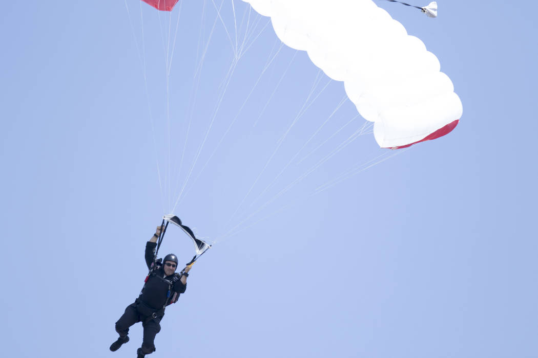 A parachuter prepares to land on the field of the Oakland-Alameda County Coliseum prior to the Oakland Raiders game against the New York Jets in Oakland, Calif., Sunday, Sept. 17, 2017. Heidi Fang ...