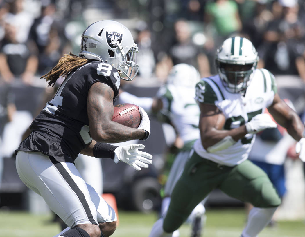 Oakland Raiders wide receiver Cordarrelle Patterson (84) carries the ball in the first half of the game against the New York Jets in Oakland, Calif., Sunday, Sept. 17, 2017. Heidi Fang Las Vegas R ...