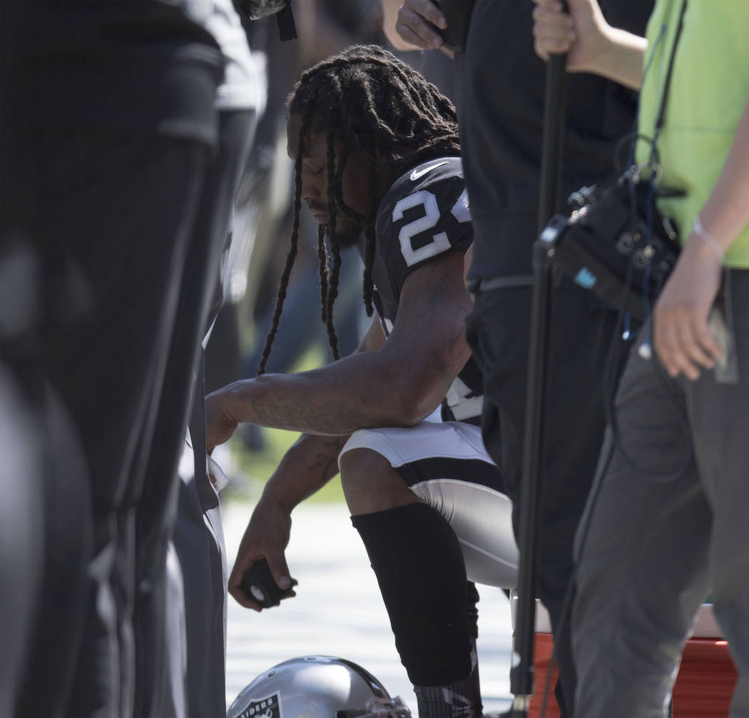 Oakland Raiders running back Marshawn Lynch (24) sits during the national anthem in Oakland, Calif., Sunday, Sept. 17, 2017. Heidi Fang Las Vegas Review-Journal @HeidiFang