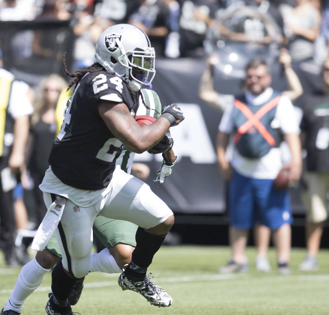 Oakland Raiders running back Marshawn Lynch (24) carries the football in the first half of their game against the New York Jets in Oakland, Calif., Sunday, Sept. 17, 2017. Heidi Fang Las Vegas Rev ...