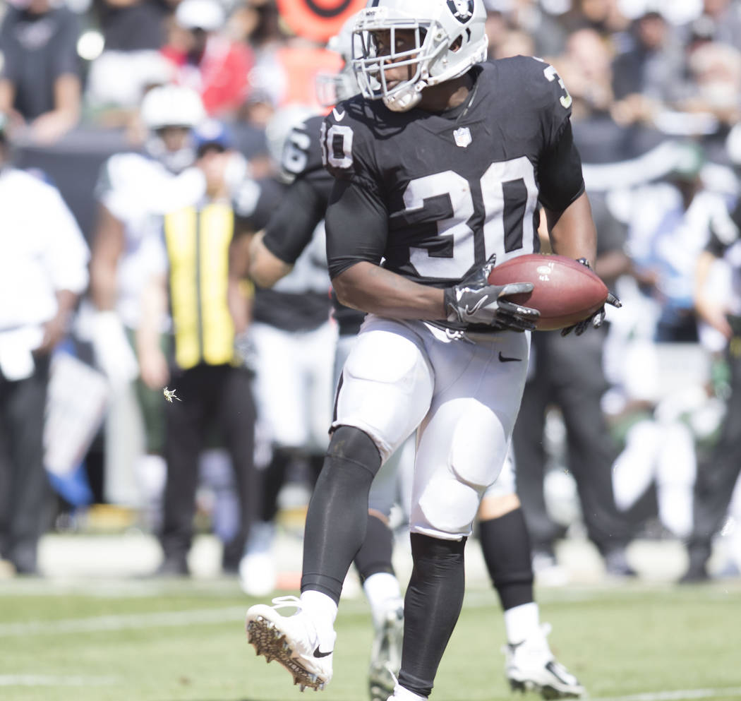 Oakland Raiders running back Jalen Richard (30) carries the football in the first half of their game against the New York Jets in Oakland, Calif., Sunday, Sept. 17, 2017. Heidi Fang Las Vegas Revi ...