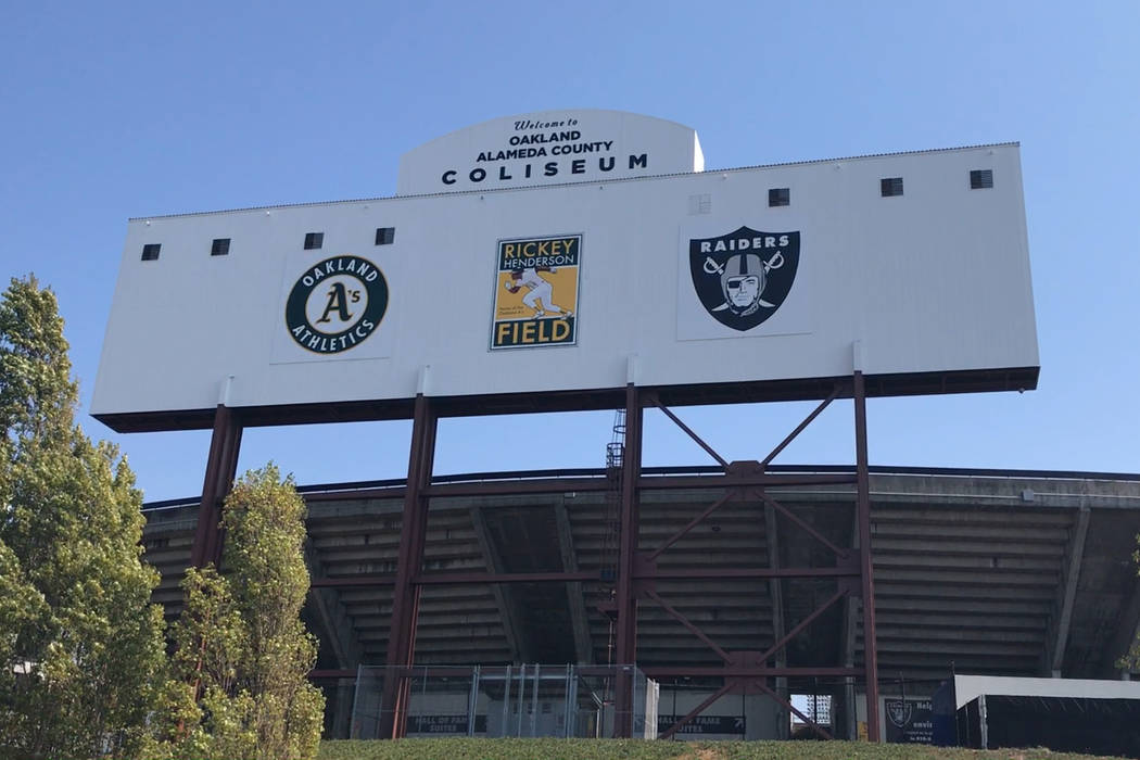A billboard outside the stadium showing logos of both teams that play at the Oakland-Alameda County Coliseum on Saturday, Aug. 19, 2017. Heidi Fang Las Vegas Review-Journal @HeidiFang