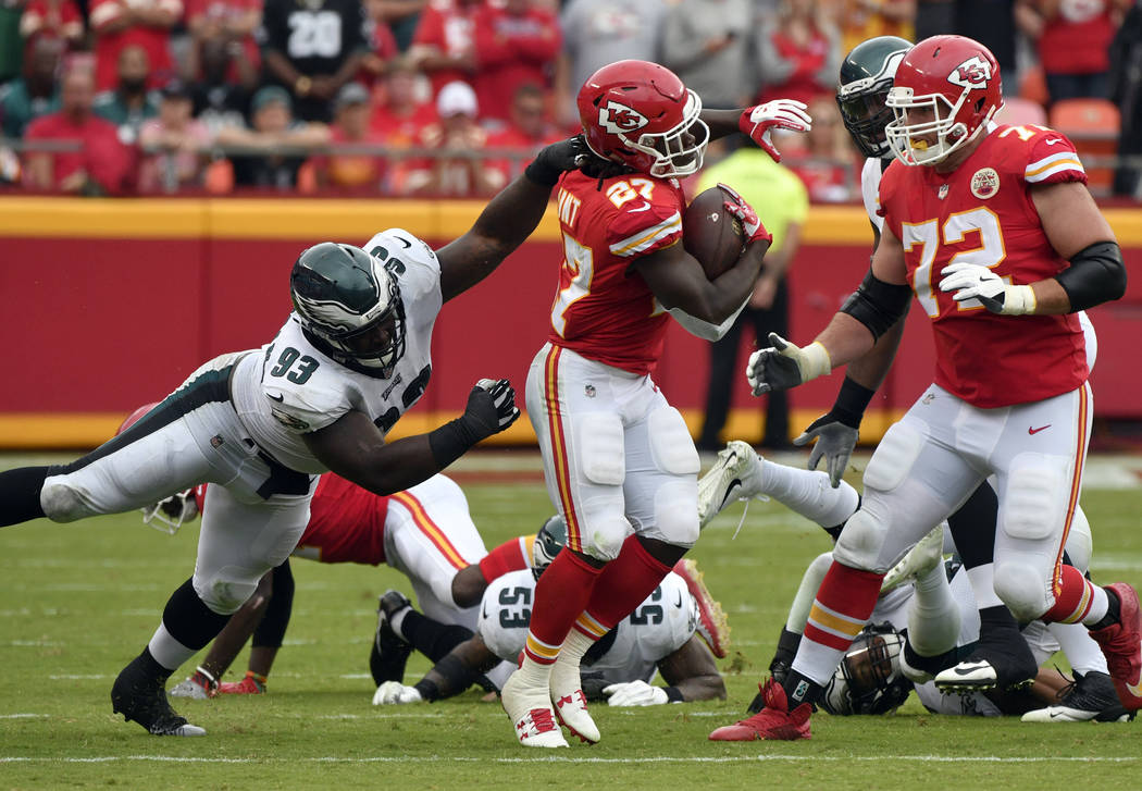Kansas City Chiefs running back Kareem Hunt (27) is tackled by Philadelphia Eagles defensive tackle Tim Jernigan (93) during the second half of an NFL football game in Kansas City, Mo., Sunday, Se ...