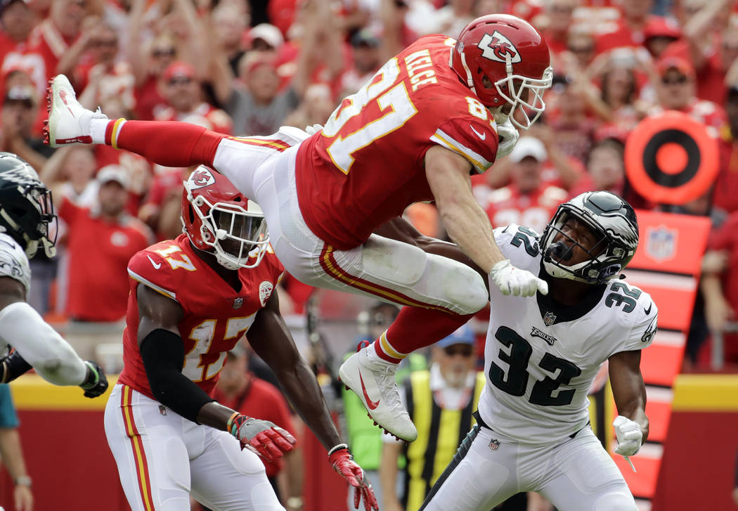 Kansas City Chiefs tight end Travis Kelce (87) leaps over Philadelphia Eagles cornerback Rasul Douglas (32) for a touchdown during the second half of an NFL football game in Kansas City, Mo., Sund ...