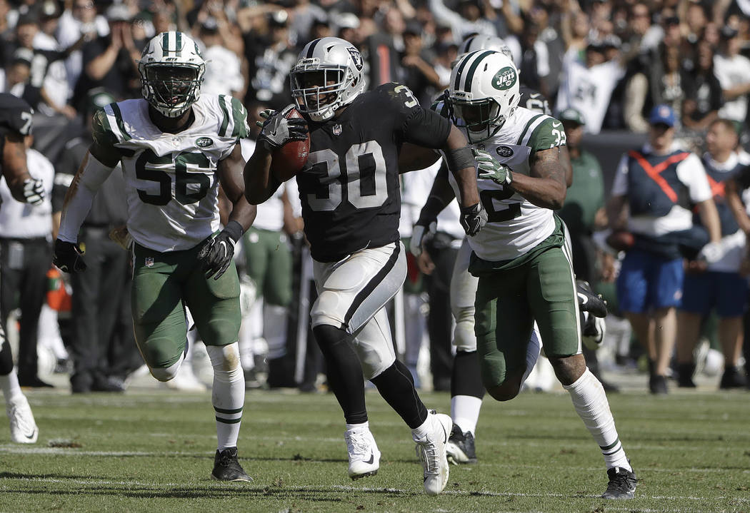 Oakland Raiders running back Jalen Richard (30) runs for a touchdown against the New York Jets during the second half of an NFL football game in Oakland, Calif., Sunday, Sept. 17, 2017. (AP Photo/ ...