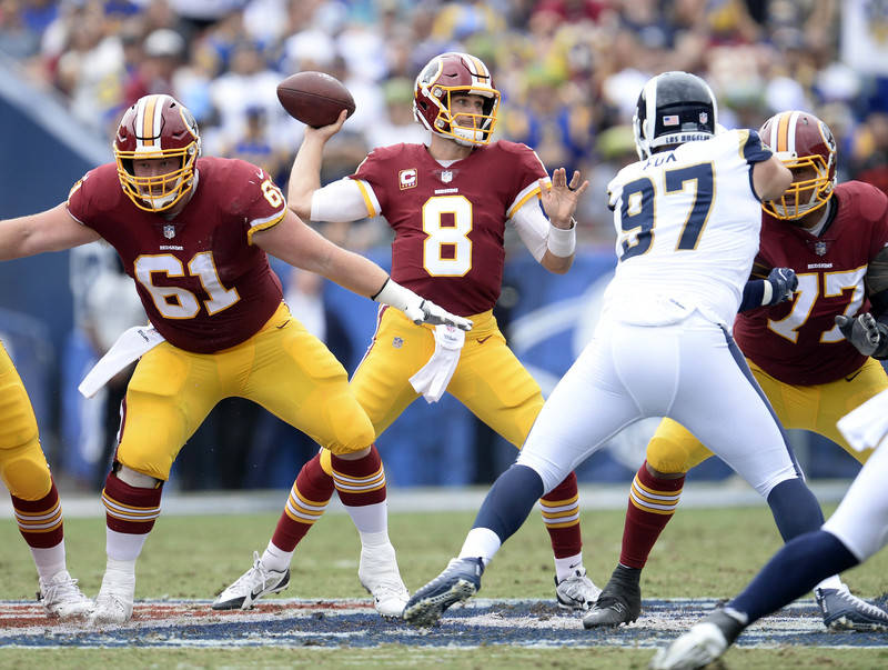 September 17, 2017; Los Angeles, CA, USA; Washington Redskins quarterback Kirk Cousins (8) throws against the Los Angeles Rams during the first half at Los Angeles Memorial Coliseum. Mandatory Cre ...